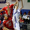 St.  Michael's, Matt Barela, #50, goes up for a layup while Bernalillo's Omar Luna, #45 and Jordan Ludi, #33 try and retrieve the ball during the second quarter of their game at Perez-Shelly Gymnasium on Tuesday, December 14, 2010. St. Michael's was  up 55-47 the last two minutes of their game.<br /> Photos by Jane Phillips/The New Mexican
