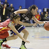 Española's Krista Bustos, number 21, tries to recover a loose ball from St. Mike's Cristina Gabaldon, number 3, during the second quarter of the St. Mike's vs Española girls basketball game on Saturday, December 29, 2012, at St. Mike's. Photo by Luis Sánchez Saturno/The New Mexican