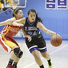 Española's Kaitlyn Romero, number 10, covers St. Mike's Elizabeth Serrono, number 24, during the first quarter of the St. Mike's vs Española girls basketball game on Saturday, December 29, 2012, at St. Mike's. Photo by Luis Sánchez Saturno/The New Mexican