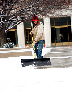 Jeff Sandoval shovels the snow at the Capitol on Wednesday, February 2, 2011.  Bitterly cold weather is expected for the next few days. Photos by Jane Phillips/The New Mexican
