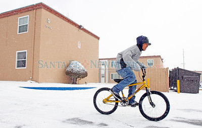 Jovani Estrada, 12, rides his bike for hours in the parking lot of Santa Fe Apartments where he lives with his family in Santa Fe, N.M., on Feb. 2, 2011. Natalie Guillén/The New Mexican
