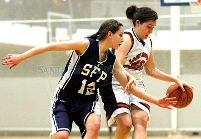 Sarah Ihlefeld (check spelling) (left) of Santa Fe Prep tries to take the ball from Monte del Sol's Kariann Ortega (right) during the second quarter of a girls basketball game at the Genoveva Chavez Center in Santa Fe, N.M. on Feb. 7, 2011.  Natalie Guillén/The New Mexican