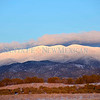 The snow capped Sangre De Chriso Mountains to the east of Santa Fe, New Mexico. Wednesday January 30, 2013. Clyde Mueller/The New Mexican©