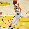 Santa Fe High Mariah Solano,#13, goes for a layup during the second quarter of their game against Los Alamos on Wednesday, February 9, 2011 at the Toby Roybal Gymnasium in Santa Fe.<br /> Santa Fe was up 9-7 at half-time.<br /> Photos by Jane Phillips/The New Mexican