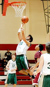 Desert Academy's captain Ron Khalsa, #22 goes up for a layup during the second quarter of their game against Tohajillee at New Mexico School for the Deaf on Friday, February 11, 2011.  Tohajillee won 77-50. Photos by Jane Phillips/The New Mexican