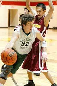 Desert Academy's captain Alex Kokesh,#32 drives the ball around Tohajillee's Jasper Nelson during the third quarter of their game at New Mexico School for the Deaf on Friday, February 11, 2011.  Tohajillee won 77-50. Photos by Jane Phillips/The New Mexican