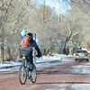 A bicycle rider makes his way along a snow covered Acequia Madre Wednesday, February 15, 2012 in Santa Fe, New Mexico. The weather caused some icy roads and a two-hour delay for Santa Fe schools.  <br /> Clyde Mueller/The New Mexican