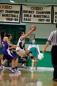 The first quarter of the Pojoaque Valley High School vs St. Michael's High School on Feb. 21, 2011, at Pojoaque.   Photo by Luis Sánchez Saturno/The New Mexican
