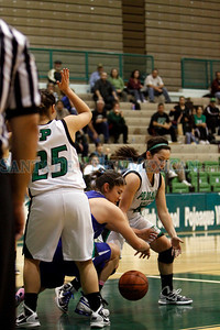 St. Mike's Lauren Blea, number 30, and Pojoaque's Kiana Vigil, number 5, go for a loose ball during the second quarter of the Pojoaque Valley High School vs St. Michael's High School on Feb. 21, 2011, at Pojoaque.   Photo by Luis Sánchez Saturno/The New Mexican