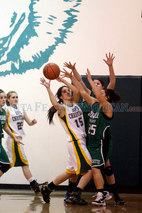 Hope Christian's Tessa Flores, number 15, is double teamed by Pojoaque's Liz Gomez, number 40, and Gabby Gonzales, number 25, during the first quarter of the Hope Christian High School vs Pojoaque Valley High School at Hope Christian on Feb. 23, 2011.  Photo by Luis Sánchez Saturno/The New Mexican