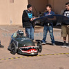 The Santa Fe High Bomber is ready to take on all comers — even though it spent much of its initial test drive in an unexpected pit stop Wednesday morning February 6, 2013.<br /> Students in the school's automotive, automotive-collision, and welding classes teamed up to build the 8-foot long, 200-pound solar/electric midget car — made out of fiberglass and other materials — over the past 18 months. Senior Joaquin Piñeda sat in the driver's seat Wednesday as he tested the car's speed, stability, and safety. Clyde Mueller/The New Mexican