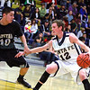 Santa Fe High Demon's  Wyatt  Honstein, #12 dribbles the ball  while Capital High Jaguar's Christian Martinez, #10 tries to defend  during the first quarter of their game at the Toby Roybal Memorial Gymnasium on Wednesday February 6, 2013.  Jane Phillips/The New Mexican
