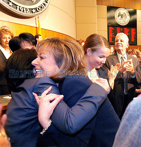 Republican Gov. Susana Martinez is congratulated after her state of the address on the opening day of the 60-day legislature session  on Tuesday, January 18, 2011.  Reinstating the death penalty, don't raise taxes but cut spending on school administration costs and reduce film production incentives were some of the goals she spoke of. Photos by Jane Phillips/The New Mexican