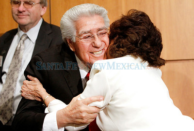 House Speaker Ben Lujan gets a congratulations hug from his wife after he won re-election to the top leadership post Tuesday after an expected challenge from fellow Democrat Joseph Cervantes fizzled as the Legislature convened.  Cervantes was not nominated for the speakership, a sign that he lacked the votes to oust Lujan. Photos by Jane Phillips/The New Mexican
