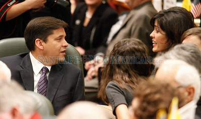Representative Joseph Cervantes speaks with his wife, Jennifer, before the vote for Speaker of the House on the first day of the legislative session in Santa Fe, N.M., on Jan. 18, 2010.  Natalie Guillén/The New Mexican