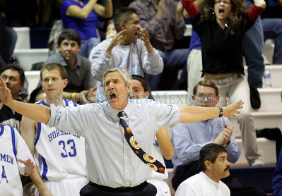Ron Geyer, head basketball coach at St. Michael's High School, is frantic with less than ten seconds left in a boys basketball game against Sandia Prep held in Santa Fe, N.M., on Jan. 20, 2011.  Natalie Guillén/The New Mexican