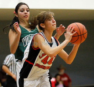 The Lady Wildcats' best player, Estrella Flores, who has averaged almost 30 points per game, plays with her Desert Academy Teammates against Monte Del Sol,  in SantaFe, N.M., on Jan 4, 2010. Natalie Guillén/The New Mexican
