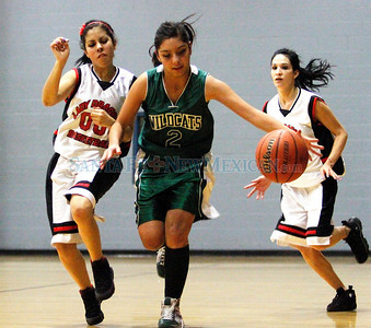 Estrella Flores (center), of Desert Academy, beats Monte Del Sol's (left) Pennie Soto and (right) Felicia Anaya, during a basketball game held at the Genoveva Chavez Community Center in SantaFe, N.M., on Jan 4, 2010. Natalie Guillén/The New Mexican