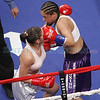 Amber Trujillo, left, from Española, NM, gets a left hook to the face by Cecilia Renova, from Albuquerque, during the 3rd round of their fight during ESPN's Friday Night Fights at the Santa Fe Indian School's Pueblo Pavilion Wellness Center on Friday, January 11, 2013. Renova won by unanimous decision. Photo by Luis Sanchez Saturno/The New Mexican