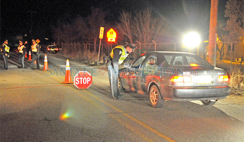 New Mexico State Police held a DWI checkpoint on Agua Fria Friday, January 14, 2011 from 11 p.m til 3 a.m  Saturday, January 15, 2011. <br /> Clyde Mueller/The New Mexican