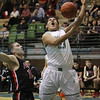 The first quarter of the Grants vs Pojoaque boys basketball game at Pojoaque High School on Jan. 16, 2013. Photo by Luis Sanchez Saturno/The New Mexican