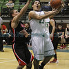 Grants' Jacob Willcox, number 10, covers Pojoaque's Brandon Bustos, number 23, as he goes for a layup during the first quarter of the Grants vs Pojoaque boys basketball game at Pojoaque High School on Jan. 16, 2013. Photo by Luis Sanchez Saturno/The New Mexican