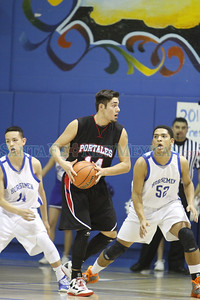 The first quarter of the St. Michael's High School vs Portales High School basketball game at St. Mike's on January 18, 2014, during the Horsemen Shootout. Luis Sanchez Saturno/The New Mexican