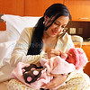Samatha Montoya holds her daughter, Juliet Madie Masillas, born at 12.35am, the first baby of 2011 in Santa Fe, N.M..<br /> Natalie Guillen/The New Mexican