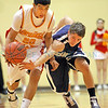 Santa Fe's Josh Roybal, number 22, tries to recover the ball from  Española's Zac Trujillo, number 20, during the first quarter of the Española Valley High School vs Santa Fe High School at Española on Jan. 19, 2011.          Photos by Luis Sanchez Saturno/The New Mexican