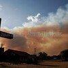 Smoke rolls up behind the United Methodist Church on Hwy 30 between Santa Clara Pueblo and Española on June 30, 2011.<br /> Natalie Guillén/The New Mexican