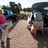 Brad Duni, right, from Santa Fe, helps Marian Kirchner, from White Rock, pack her car to go back home on June 30, 2011. Kirchner and her mother Nora Soderberg, 93, are being hosted in Santa Fe at Duni's Las Campanas home. In the middle of packing to go back Kirchner received a call from a neighbor saying that it was still not a good time to return.<br /> <br /> Photo by Luis Sánchez Saturno/The New Mexican