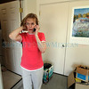 Marian Kirchner, from White Rock, talks on the phone with a neighbor who told her it is still not a good time to return on June 30, 2011. Kirchner and her mother Nora Soderberg, 93, are being hosted in Santa Fe at Brad Duni's Las Campanas home.<br /> <br /> Photo by Luis Sánchez Saturno/The New Mexican