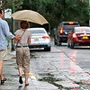 Mike Horeff, from Denver, CO, walks with his wife Alice Keane in downtown Santa Fe during the rain on June 30, 2011.<br /> <br /> Photo by Luis Sánchez Saturno/The New Mexican