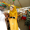 From left, Hamed Thabet Al Senadidi and Salma Said Al Hajri from the Al Najoom Dance Troupe light some incensents  while Sheri Auammiui of Nigeria looks on during the opening night at the Folk Art Market on Friday, July 9, 2010. <br /> Photos by jane Phillips/The New Mexican