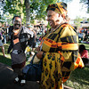 From left, Macdziphathi Mlungisi Dlamini of Swaziland and Janet Nkubana of Rwanda enjoy dancing to, Tradison, a band from Cuba at the 2010 Folk Art Market kick-off  concert on Thursday, July 8, 2010.<br /> Photos by Jane Phillips/The New Mexican