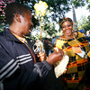 From left, Macdziphathi Mlungisi Dlamini of Swaziland and Janet Nkubana of Rwanda enjoy the music of  Tradison, a band from Cuba at the 2010 Folk Art Market kick-off  concert on Thursday, July 8, 2010.<br /> Photos by Jane Phillips/The New Mexican