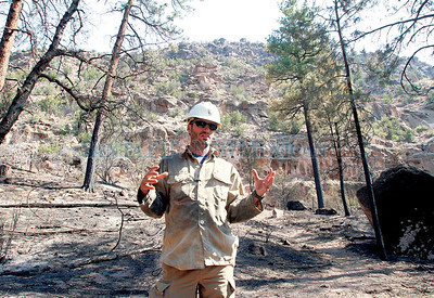 Supervisor for the fire youth team at Bandelier National Monument Firefighter, Matt Dutton, speaks about the destruction in middle  Frijoles canyon on Wednesday, July 6, 2011.   Photos by Jane Phillips/The New Mexican