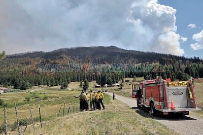 Firefighters meet at the ranch in the Jemez Mountains ranch owned by Roger Cox is the where the Los Conchas fire, the largest fire on record in New Mexico, is where the fire was believe to have started.  Clyde Mueller/The New Mexican