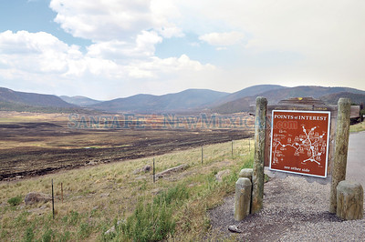 Hundreds of acres of grassland lie burned in the Valles Caldera National Perserve, New Mexico in the wake of the Los Conchas fire as seen from NM state road 4 taken Friday, July 8, 2011.  Clyde Mueller/The New Mexican