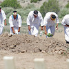 Members of the Voladores participate in a pole-raising ceremony at Las Golondrinas, in Santa Fe, NM.,  on July 16, 2010. Santa Fe, N.M.. Traditionally, a chicken is sacrificed into the hold before placing the pole, but in Santa Fe the voladores agreed to used eggs instead. The 'Voladores de Papantla' are Totonac Indians, and the voladores rite is a traditional act of worship (now most often performed as entertainment for tourists, as in these pictures). The voladores climb to the top of a tall pole, wind ropes around the pole, and then leap off into the air. As the ropes unwind, they descend slowly to the ground. The caporal plays a drum and flute and invokes an ancient spiritual offering in the form of a spectacular dance.<br />  Natalie Guillén/The New Mexican