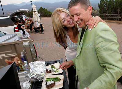 Ragnar & Nora Storaasli of Colorado enjoy fixing their meal while tailgating at the opening night of Faust  at the Opera on Friday, July 1, 2011in Santa Fe, New Mexico. This is Ragnar's 14th year and Nora's first year at the opera. Photos by Jane Phillips/The New Mexican
