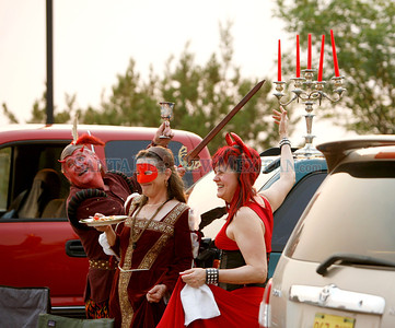 From left, Tim Willson, cq, Nancy Maret and Fitzhugh Cline,cq, have fun tailgating before the opening night of Faust at the Opera on Friday, July 1, 2011 in Santa Fe, New Mexico. Photos by Jane Phillips/The New Mexican