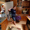 Sonja Smith, 17, from Los Alamos, moves things back into her home on July 3, 2011. Sunday was the first day that residents were allowed to move back to their homes in Los Alamos.<br /> <br /> Photo by Luis Sánchez Saturno/The New Mexican