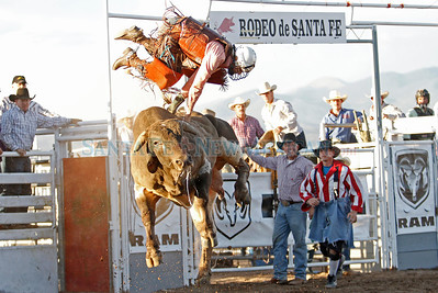 Sam Wyatt, of Fittstown, Oaklahoma, is thrown from a bull during Rodeo de Santa Fe at the Santa Fe Rodeo Grounds on June 23, 2011.   Natalie Guillén/The New Mexican