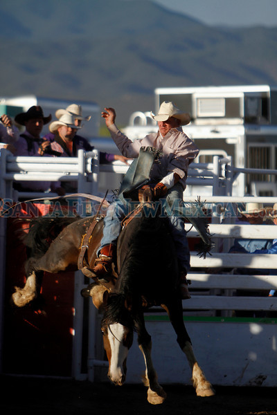 Guy Murphy, 55, from Black Cat City, NM, rides on Fiesta De at the Rodeo De Santa Fe during the bareback riding event on June 24, 2011.<br /> <br /> Photo by Luis Sanchez Saturno/The New Mexican