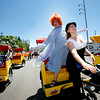 Molly Burger drives Richard Peters around during the  annual Pride Parade on Saturday, June 26, 2010.  The parade<br /> started at the Capitol and ended at the Railyard for more festivities.<br /> Photos by Jane Phillips/The New Mexican