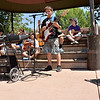 Students enrolled in the Santa Fe Public Schools' summer music camp program led by teacher Brandelyn Davidson play their guitars and sing for passersby's at 11 a.m at the Santa Fe Plaza on Friday, June 22, 2012. <br /> Clyde Mueller/The New Mexican