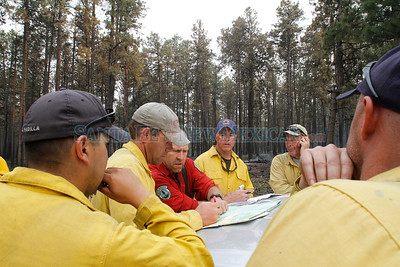 Operation section chief and fire fighters look over their next plan of action during the second day of the Las Conchas Fire by ST RD 4 in  Los Alamos on Tuesday, June 28, 2011.  Photos by Jane Phillips/The New Mexican