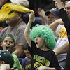 Joshua Gonzales, 7, from Pecos, cheers on his home team during the third quarter of their quarter final state championship game against Messilla Valley at the Santa Ana Star Center on Wednesday, March 13, 2013. Photo by Luis Sanchez Saturno/The New Mexican