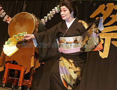 Director, Chizuko Matsumoto, with Hanayagi Dance Group performs solo during the 10th annual Japan Festival at the Santa Fe Convention Center on Saturday, March 22, 2014.  Jane Phillips/The New Mexican